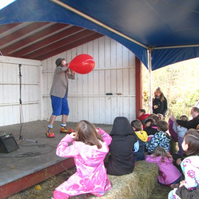 Poco the clown performs at old field orchard Victoria BC